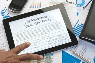 image of man filling out life insurance application